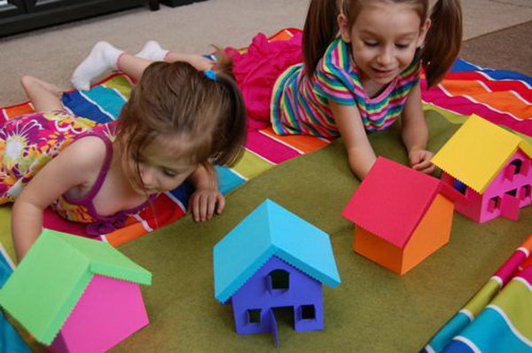 Build  Rainbow Village. Use your free colorful cardstocks to make this rainbow village. Use bits of velcro to hold the houses together. Your kids can  build and re-build the rainbow village over and over again with different color combinations. Learn more here.