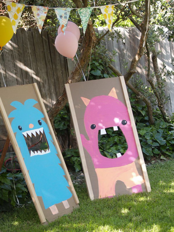 Monster Bean Bag Toss. Make big monster out of cardboard. They doubled as a bean bag toss game as well as a picture taking backdrop. The kids must enjoy this game very much to cool off and have a lot of fun in summer.