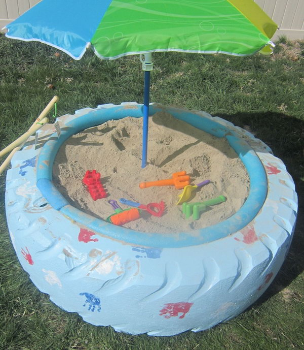 Sandbox with a Tyre. Summer is a good time for boys to play sand. Paint the tyre in light color so it won't get so hot in the sun. Cover the jagged edge with pool noodle. You can also place umbrella at the top of the box to avoid the burning sun.