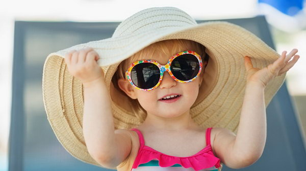 Sunglass and Hat. Kids are more susceptible to retinal damage than adults. It's more important to protect eyes for kids.  So encourage your kids to rock a hat and sunglasses every time they go outside.