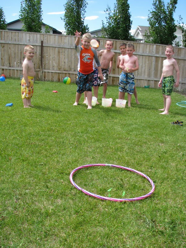 Water Balloon Target Toss. Pull out the hula-hoop and toss your water balloons at the target. You can group the players and count how many each team hits the target to raise the team spirit for kids in this funny game.