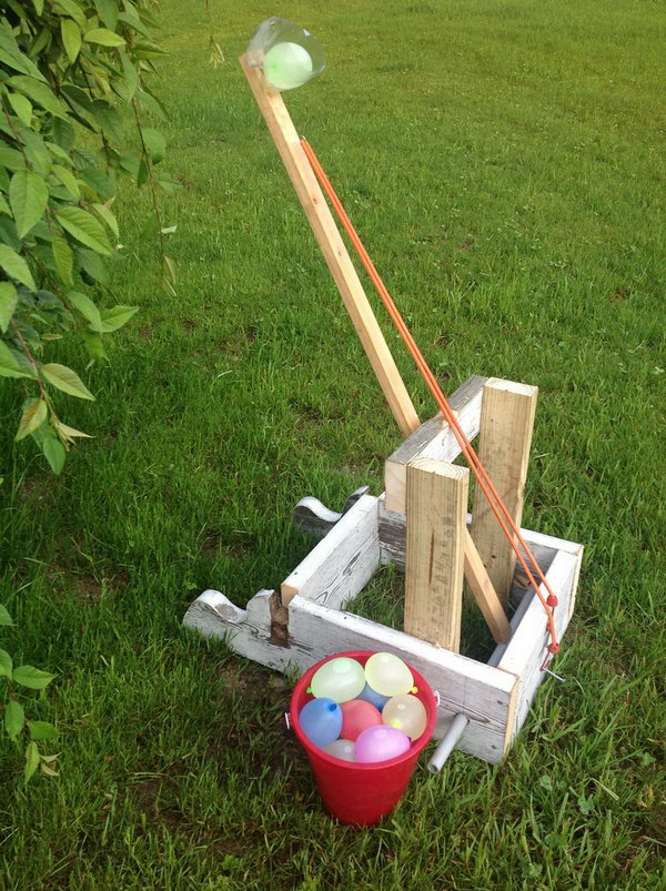 Water Balloon Catapult Launcher. Secure the bottom part of the soda bottle at the end of the wooden catapult and fasten it with the rubber band. Use the bottle to display your water balloon. Just release the band, aim and fire your water balloon. So exciting.