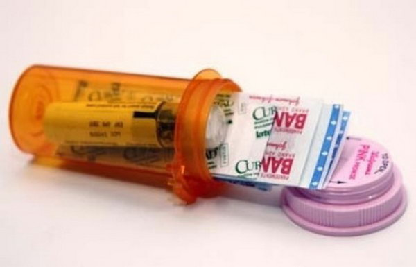 DIY Mini First aid Kit Using a Prescription Bottle. See more details