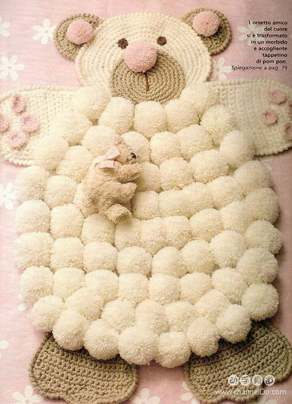 DIY Simple Crocheted Finger Pom-poms Bear Rug. This will be the perfect addition to any nursery and make a wonderful way to add a little pop to your space.