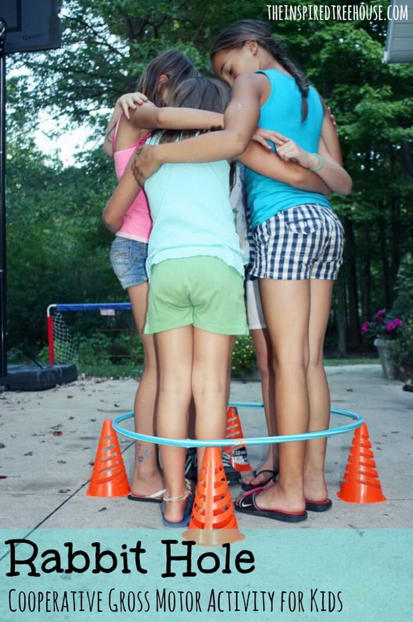 Rabbit Hole Team Building Activity. Children pack themselves into a tight circle and move around inside the hula hoop without dropping down the cones or other objects, which are used to prop the hula hoop off the ground. Imagination is the key in this challenge. This is a great activity to teach kids about personal space and build teamwork. Get more details