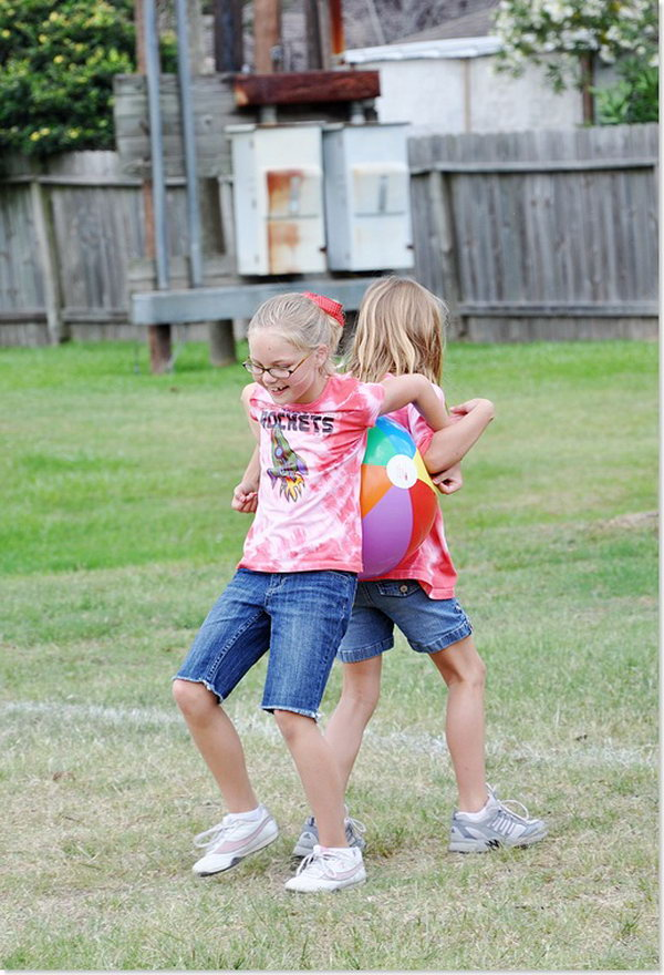 Beach Ball Race.  Kids work together to hold beach ball between their backs for the first leg of the race, then their sides, then elbows.