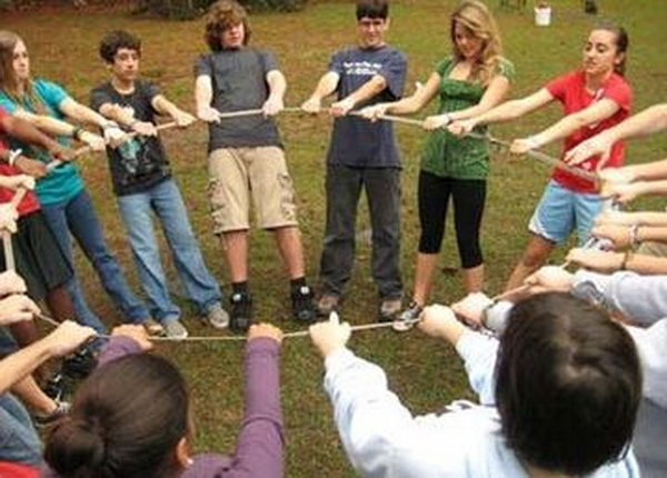 Geometry Outdoor Teamwork Game. The groups must create assigned geometric shapes.