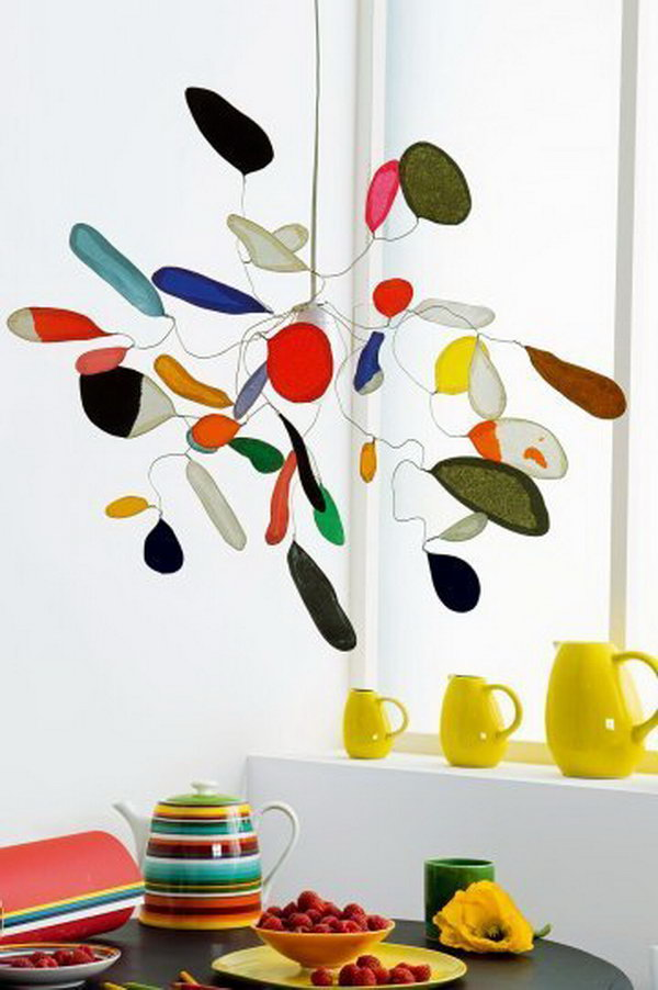 Calder-Inspired Mobile Made with Tissue Paper and Wire. This tissue paper mobile looks sophisticated enough to hang in any room in the house. See more directions