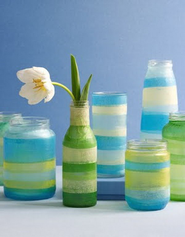 Adorable Sea Colored Vases with Tissue Paper. Glasses, jars, votive candle holders or small vases, colored tissue papers, Mod Podge decoupage glue, brush and scissors are all you need to make this craft. Get the tutorial
