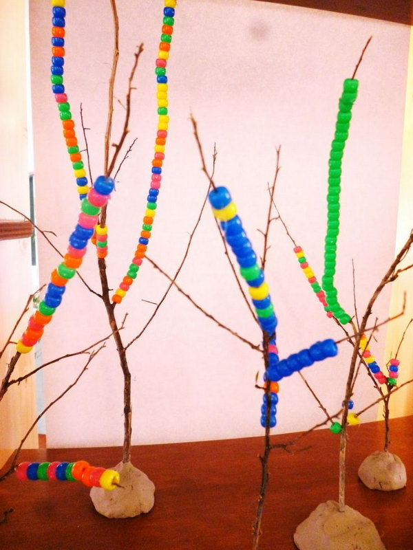 Threading Beads onto Twigs.
