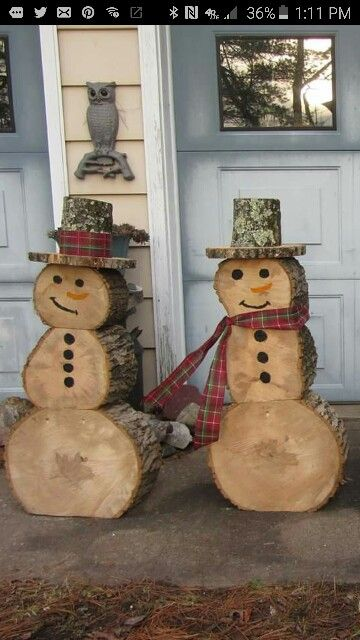 Snowmen Made Out of Recycled Logs in Your Yard.