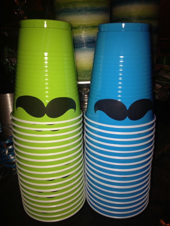Decorate your cups with mustache stickers.